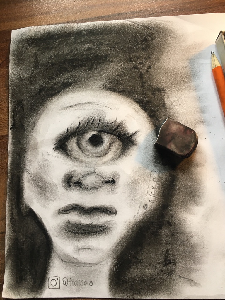 charcoal drawing of a person's head with one eye